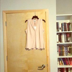Nude sleeveless office shirt.